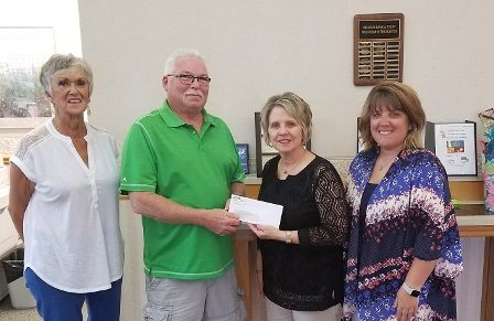 Peoples Bank & Trust presenting members of the Red, White, & Blue Days committee with a donation.