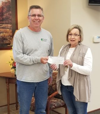 Peoples Bank & Trust presenting AMVETS with a donation to replace flags in Taylorville.
