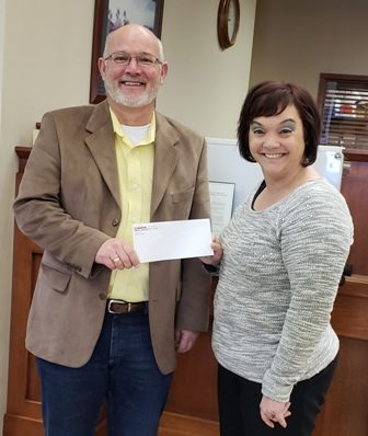 Peoples Bank & Trust presents Taylorville School District with donation to purchase a new plasma cutter for the vocational education program.